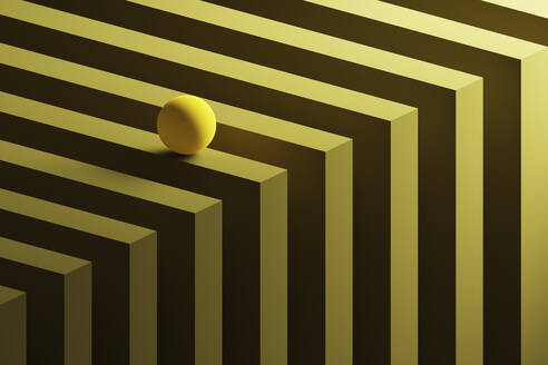 Three dimensional render of small yellow sphere rolling over geometric pattern - DRBF00164