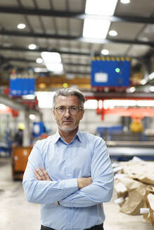 Portrait of a confident mature businessman in a factory - MOEF03001