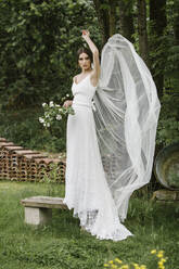Young woman in elegant wedding dress and bouquet - ALBF01270