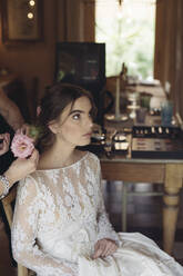 Hairdresser with flower for hair of bride - ALBF01273