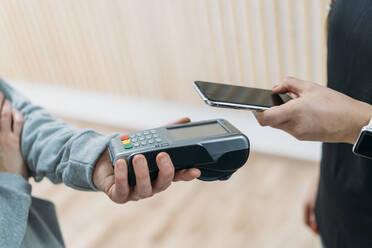 Paying cashless with smartphone at health club - MPPF00958