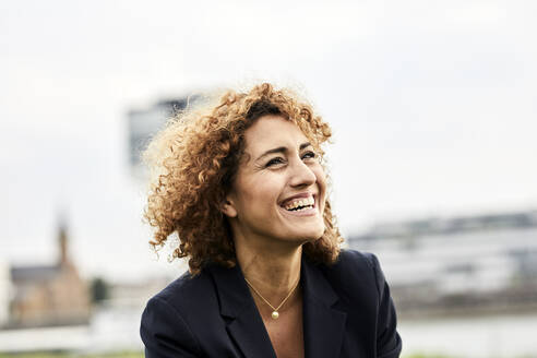 Portrait of smiling businesswoman - MJFKF00336