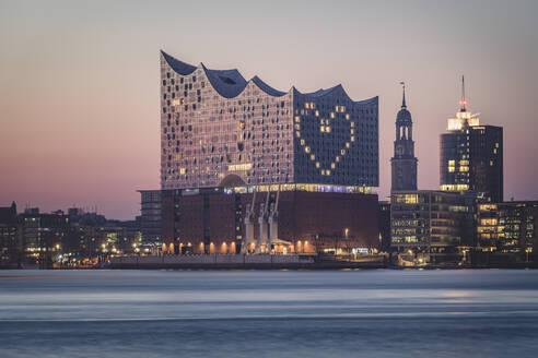 Germany, Hamburg, Heart shape displayed on Elbphilharmonie at dusk - KEBF01538