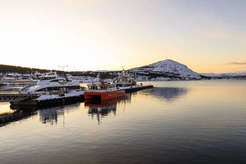 Port, ferry and boats, Altafjord, sea, mountains, snow, winter sunset, Alta, Troms og Finnmark, Arctic Circle, North Norway, Scandinavia, Europe - RHPLF15214