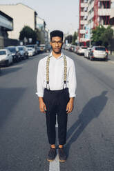 Portrait of a confident stylish young man standing on the street in the city - MEUF00777