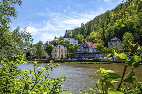 Germany, Rhineland-Palatinate, Bad Ems, Riverside town on sunny day - PUF01913