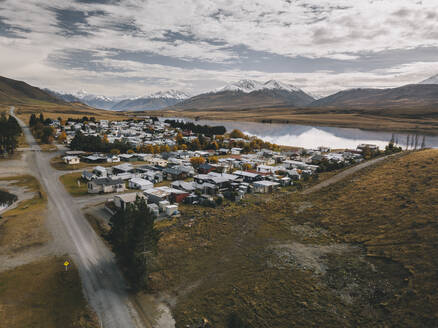 Lake Clearwater village with the Southern Alps in the background. NZ - CAVF85394
