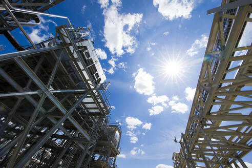 Natural gas plant structures against blue sky - CAVF85451