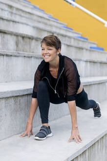 Athletic woman during workout on stairs - LVVF00081