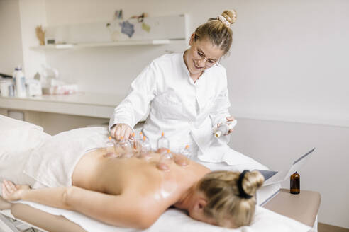 Cupping therapy, treatment at back - DAWF01705