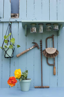 Various tools hanging under DIY shelf with attached jars - GISF00614
