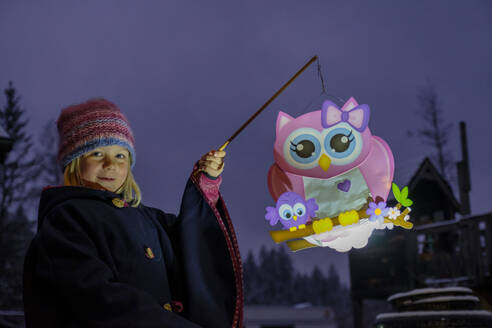 Portrait of proud little girl with paper lantern in the evening - LBF03089
