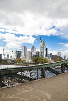 Germany, Frankfurt, Downtown skyscrapers seen from bridge on Main river - FLMF00260