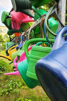 Colorful watering cans on a cemetery, Berlin, Germany - NGF00555
