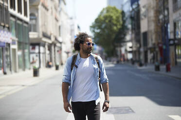 Portrait of young man in the city, Oxford Street, London, UK - PMF01134