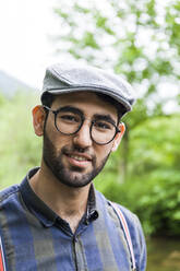 Portrait of young man wearing glasses and  cap - TCF06287