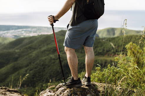 Hiker at the top of a mountain - XLGF00276