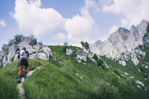 Hiker walking on mountain path, Orobie, European Alps, Como, Italy - MCVF00479