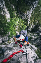 Mountaineer climbing on via ferrata, Orobie, European Alps, Como, Italy - MCVF00485