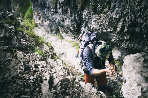 Mountaineer climbing on via ferrata, Orobie, European Alps, Como, Italy - MCVF00488