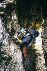 Mountaineer climbing on via ferrata, Orobie, European Alps, Como, Italy - MCVF00491