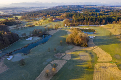 Germany, Bavaria, Wolfratshausen, Drone view of countryside golf course at dawn - LHF00797