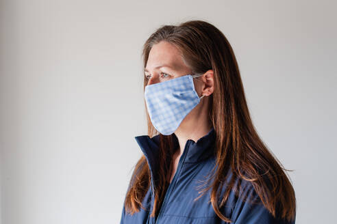 Woman wearing homemade cloth face mask during Covid 19 pandemic. - CAVF86428