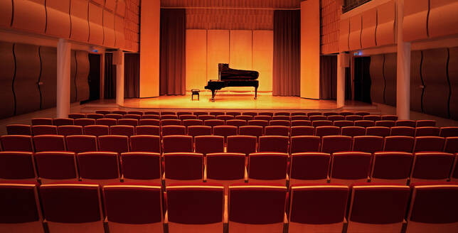 Image of a piano on stage inside an empty concert hall - CAVF86563