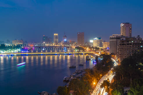 Egypt, Cairo, Nile and downtown skyline at night - TAMF02458