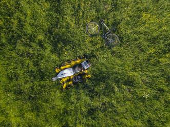 Aerial view of young woman at the green lawn, Tikhvin, Russia - KNTF04734