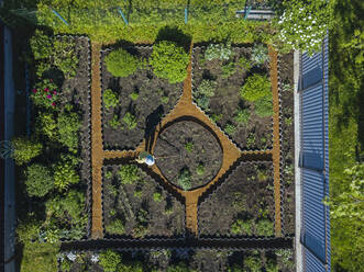 Aerial view of female worker at garden, Tikhvin, Russia - KNTF04743