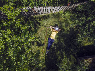 Aerial view of woman resting at garden, Tikhvin, Russia - KNTF04746