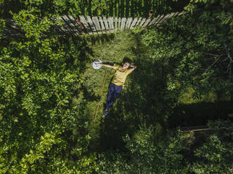 Aerial view of woman resting at garden, Tikhvin, Russia - KNTF04749