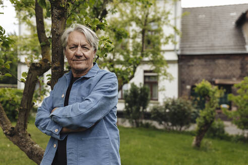Portrait of a confident senior man standing in a rural garden - GUSF04097