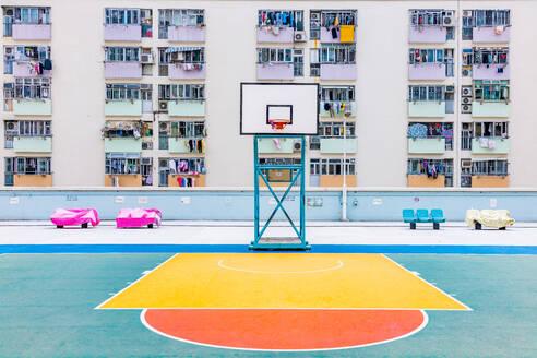 Basketball Hoop Against Buildings In City - EYF09174
