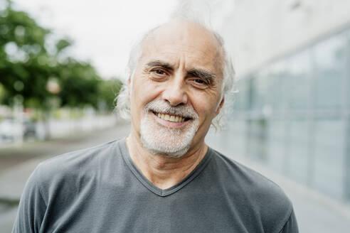 Close-up of smiling senior man in city - MEUF01187