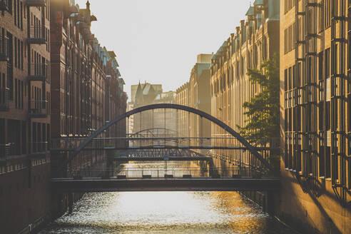 Germany, Hamburg, Bridge over canal in Speicherstadt district - IHF00366