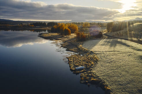 Lake and coast during sunset in autumn countryside - CAVF86812
