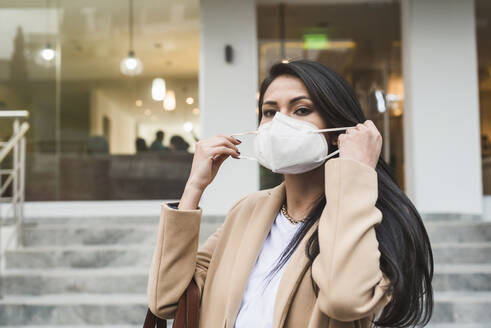 Woman with protective mask in city - DSIF00024