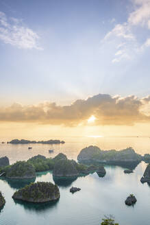 View over a bay of islands at dawn from the Piaynemo lookout, Raja Ampat, West Papua, Spice Islands, Indonesia, Southeast Asia, Asia - RHPLF15419