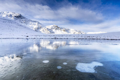 Ice bubbles on the icy surface of an alpine lake, Stelvio Pass, Valtellina, Lombardy, Italy, Europe - RHPLF15581
