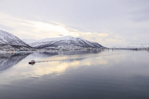 Tromso city, from its fjord, city covered in winter snow, boat, Arctic Cathedral, bridge, mountains, Tromso, Troms og Finnmark, North Norway, Scandinavia, Europe - RHPLF15659