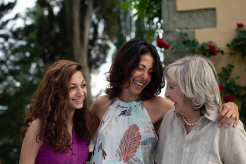 Three generations of female family together - CUF55784