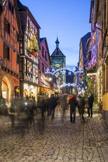 Rue du General de Gaulle covered in Christmas decorations illuminated at night, Riquewihr, Alsace, France, Europe - RHPLF16141