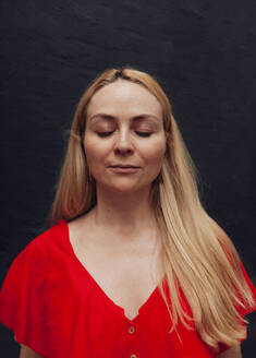 Portrait of blond woman with closed eyes - MRRF00144
