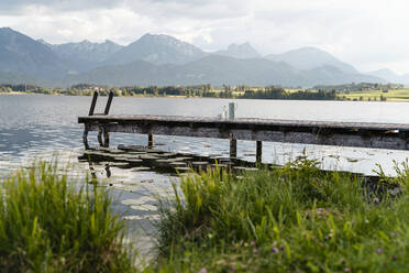 Scenic view of jetty over lake against mountains - DIGF12782