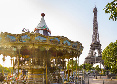 Carousel and Eiffel Tower against clear sky during sunrise, Paris, France - HSIF00760