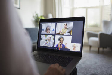 Senior women video conferencing on laptop screen - CAIF28746