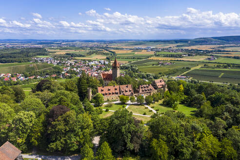 Germany, Baden-Wurttemberg, Brackenheim, Helicopter view of Schloss Stocksberg and surrounding village in summer - AMF08329