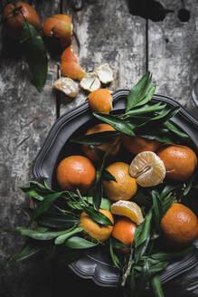 Mandarins and basket on table - ADSF08662